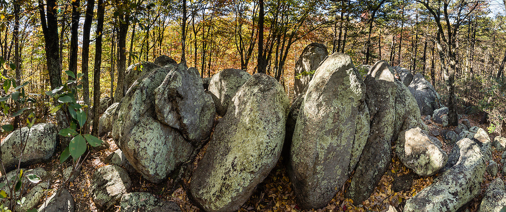 Indian Rocks, fall foliage color in mid October. Walk 0.3 miles to the impressive boulders of Indian Rocks from Indian Gap Parking Area (Milepost 47.5, elevation 2098 feet) on Blue Ridge Parkway, in Virginia, in the Blue Ridge Mountains (a subset of the Appalachian Mountains), USA. The scenic 469-mile Blue Ridge Parkway was built 1935-1987 to aesthetically connect Shenandoah National Park (in Virginia) with Great Smoky Mountains National Park in North Carolina, following crestlines and the Appalachian Trail. This panorama was stitched from 12 overlapping photos.