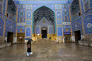 A woman walks across the forecourt of the Sheikh Lotfollah Mosque during a snow-fall in the city of Esfahan, Iran.