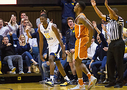 Feb 20, 2017; Morgantown, WV, USA; West Virginia Mountaineers forward Lamont West (15) celebrates after making a three pointer during the first half against the Texas Longhorns at WVU Coliseum. Mandatory Credit: Ben Queen-USA TODAY Sports