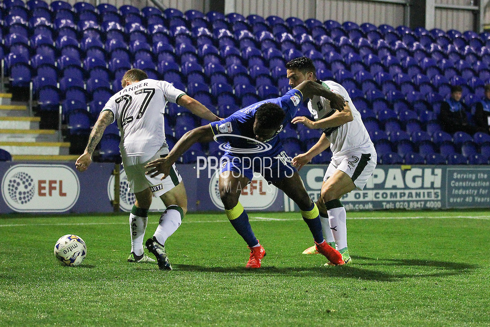 AFC Wimbledon striker Dominic Poleon (10) is caught between Plymouth Argyle striker Craig Tanner (27) and Plymouth Argyle defender & captain Gary Miller (2) during the EFL Trophy match between AFC Wimbledon and Plymouth Argyle at the Cherry Red Records Stadium, Kingston, England on 4 October 2016. Photo by Stuart Butcher.