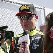 Race car driver Clint Bowyer is seen as he makes his way to the drivers meeting prior to the 58th Annual NASCAR Daytona 500 auto race at Daytona International Speedway on Sunday, February 21, 2016 in Daytona Beach, Florida.  (Alex Menendez via AP)
