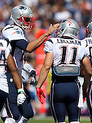 New England Patriots wide receiver Julian Edelman (11) gets a pat on the helmet from New England Patriots quarterback Tom Brady (12) after catching a first quarter touchdown pass for a 7-0 lead during the NFL week 1 football game against the Buffalo Bills on Sunday, Sept. 8, 2013 in Orchard Park, N.Y. The Patriots won the game 23-21. ©Paul Anthony Spinelli