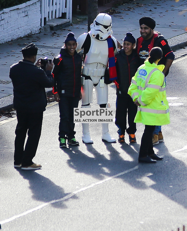 A crystal Palace fan in a stormtrooper Halloween costume takes a photo with Manchester United fans before Crystal Palace vs Manchester United on Saturday the 31st October 2015.