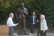 Bill Beckwith (left), Virginia Wilson Mounger (center) and Martha Lyles Wilson unveil the statue during a dedication of the LQC Lamar statue at the LQC Lamar House in Oxford, Miss. on Saturday, October 9, 2010.