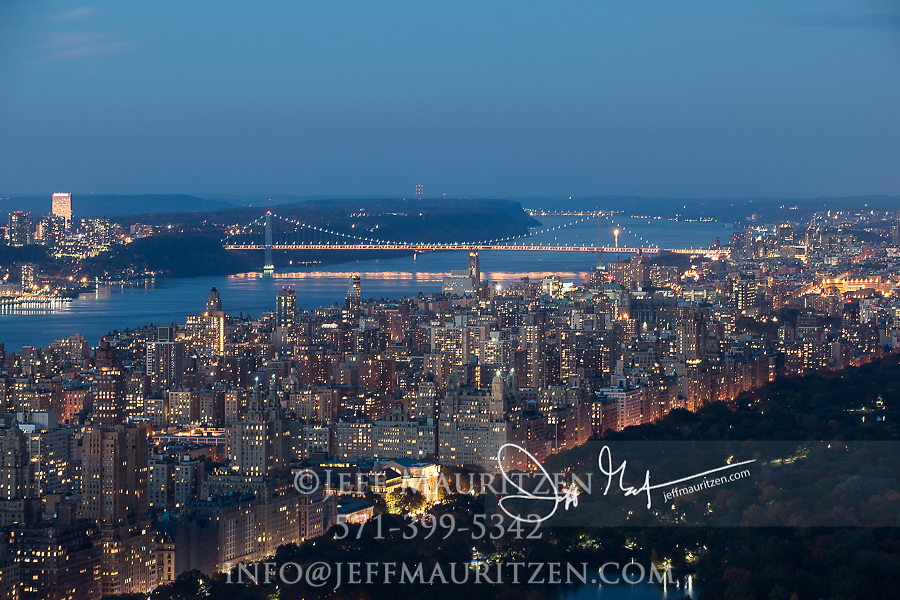 The George Washington Bridge and uptown Manhattan, NYC illuminated at night.