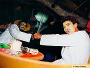 Two men playing with plastic swords, Ibiza, 2000