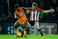 Chuba Akpom of Hull City and James Tarkowski of Brentford during the Sky Bet Championship match between Brentford and Hull City at Griffin Park, London<br /> Picture by Mark D Fuller/Focus Images Ltd +44 7774 216216<br /> 03/11/2015