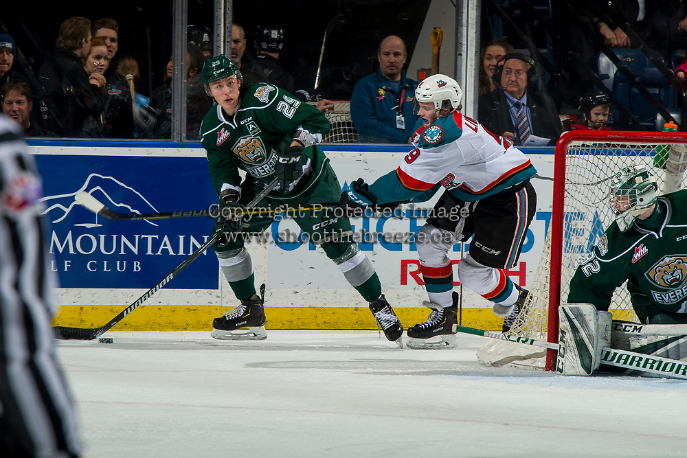 KELOWNA, CANADA - JANUARY 9:  Mark Liwiski #9 of the Kelowna Rockets stick checks Wyatte Wylie #29 of the Everett Silvertips as he skates with the puck on January 9, 2019 at Prospera Place in Kelowna, British Columbia, Canada.  (Photo by Marissa Baecker/Shoot the Breeze)