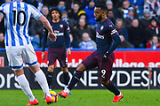 Alexandre Lacazette of Arsenal (9) passes the ball during the Premier League match between Huddersfield Town and Arsenal at the John Smiths Stadium, Huddersfield, England on 9 February 2019.