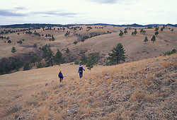 Hiking on the mixed grass prairie in Wind Cave National Park.