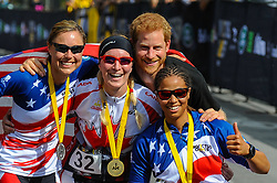 September 26, 2017 - Toronto, Ontario, Canada - Prince Harry poses with medalists in the Women's Recumbent Bike IRECB1 time trial, (L-R) silver medalist Amy Dotson of the United States, gold medalist Julie Marcotte of Canada and bronze medalist Gabby Graves-Wake of the United States at the cycling time trial at the Invictus Games in High Park in Toronto, Ontario, September 26, 2017. The first Invictus Games, based on the Paralympic Games, were held in September 2014 in London. They were launched by Prince Harry, who served with the British Army in Afghanistan. (Credit Image: © Anatoliy Cherkasov/NurPhoto via ZUMA Press)