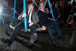 © Licensed to London News Pictures.14/01/2014. London, UK.London Mayor Boris Johnson and Richard Desmond, owner of The Health Lottery play at the Glamis Adventure Playground during their visit the Shadwell Community Project in East London in celebration of The Health Lottery's pledge to raise £10 million for local London charities by 2016.Photo credit : Peter Kollanyi/LNP