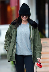 Model Daisy Lowe wearing a black beanie hat, big sunglasses, Parker jacket, grey top, black leggings and boots out walking her dog in north London, UK. 14/11/2014<br />