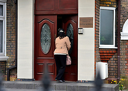 © Licensed to London News Pictures. 08/04/2013. London, UK A woman enters the North Korean Embassy in Ealing in West London today, 8th April 2013. The Embassy is based in a 1920's detached house in a residential area. Tensions are high between countries around the world and the North Koreans. Photo credit : Stephen Simpson/LNP