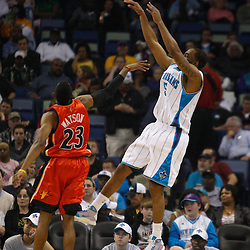 Mar 08, 2010; New Orleans, LA, USA; New Orleans Hornets guard Marcus Thornton (5) shoots a three pointer over Golden State Warriors guard C.J. Watson (23) during the first half at the New Orleans Arena. Mandatory Credit: Derick E. Hingle-US PRESSWIRE