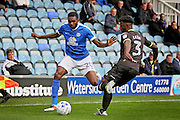 Bury FC defender Greg Leigh (3) and Peterborough United defender Hayden White (20) battle for the ball during the EFL Sky Bet League 1 match between Peterborough United and Bury at London Road, Peterborough, England on 8 October 2016. Photo by Nigel Cole.