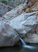 Cool creek  water flows down one of many chutes at Romero Pools, Romero Canyon.