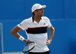 France's Julien Benneteau reacts during his match against Bulgaria's Grigor Dimitrov during day three of the 2017 AEGON Championships at The Queen's Club, London. PRESS ASSOCIATION Photo. Picture date: Wednesday June 21, 2017. See PA story TENNIS Queens. Photo credit should read: Steven Paston/PA Wire. RESTRICTIONS: Editorial use only, no commercial use without prior permission.