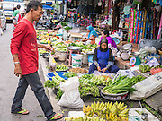 02 NOVEMBER 2012 - HAT YAI, SONGKHLA, THAILAND: A Thai man walks through the market in Hat Yai, Songkhla, Thailand. Hat Yai is the commercial center of south Thailand and a popular weekend vacation destination for Malaysian and Singaporean tourists.    PHOTO BY JACK KURTZ