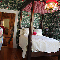 Pilgrimage guests tour a bedroom on the second floor of Lauri Mundi.