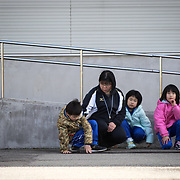 OGA, JAPAN - MARCH 17: Students with their teacher is seen at the Hokuyou Elementary School during a missile evacuation drill on Friday, March 17, 2017, in Kitaura, Oga, Akita Prefecture, Japan. During the drill, around 50 kids were instructed to walk slowly inside of a school gym, as if a missile had hit the the ground nearby. After a loud siren, people are instructed through a loud speaker to move to safer ground in the school. People participated in the first missile evacuation drill organized by the Akita prefectural office and Oga city to prepare people in the event of a North Korean Missile strike on Japan. Recently, Three of four missiles fired by North Korea may have fallen into Japan's Exclusive Economic Zone and the Japanese government has lodged a strong protest against North Korea. (Photo: Richard Atrero de Guzman/ANADOLU Agency)
