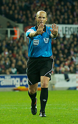 STOKE-ON-TRENT, ENGLAND - Monday, October 31, 2011: Referee Mike Dean indicates a push as he awards Newcastle United a penalty kick against Stoke City during the Premiership match at the Britannia Stadium. (Pic by David Rawcliffe/Propaganda)