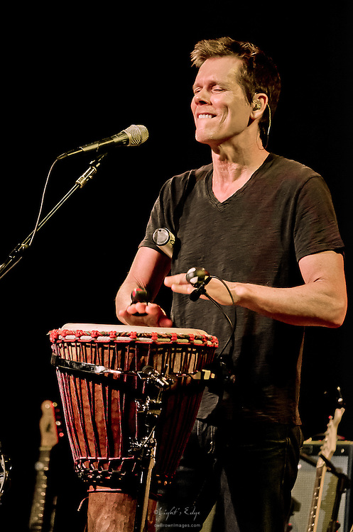 Kevin Bacon working some rhythm on the djembe and shakers during the Bacon Brothers performance at The Music Pier in Ocean City.
