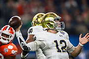 Notre Dame Fighting Irish quarterback Ian Book (12) throws  a pass during the NCAA Cotton Bowl  semi-final playoff football game against the Clemson Tigers, Saturday, Dec. 29, 2018, in Arlington, Texas. Clemson defeated Notre Dame 30-3 to advance to the College Football Playoff national Championship. (Mario Terana/Image of Sport)