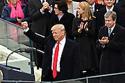 President Donald Trump holds his fist in victory following his Inaugural address after being sworn-in as the 45th President on Capitol Hill January 20, 2017 in Washington, DC.