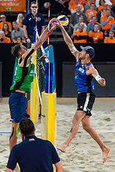 06-01-2019 NED: Dela Beach Open, Den Haag<br /> Netherlands lost the bronze medal from Russia 1-2 /  Alexander Brouwer #1 attacking but blocking Ilya Leshukov #1 give Russia the bronze medal.