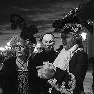 Italy. Venice Carnival ON Shiavoni quay. masked people / le Carnaval de Venise sur les quais de Shiavoni