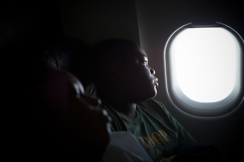 XAVIER MASCARENAS/TREASURE COAST NEWSPAPERS<br /> <br /> Calvin Minion with Boy Scout Troop 772 looks out of his window while on a plane bound for Washington D.C. on July 22, 2014. None of the boys in Troop 772 had flown before the trip.