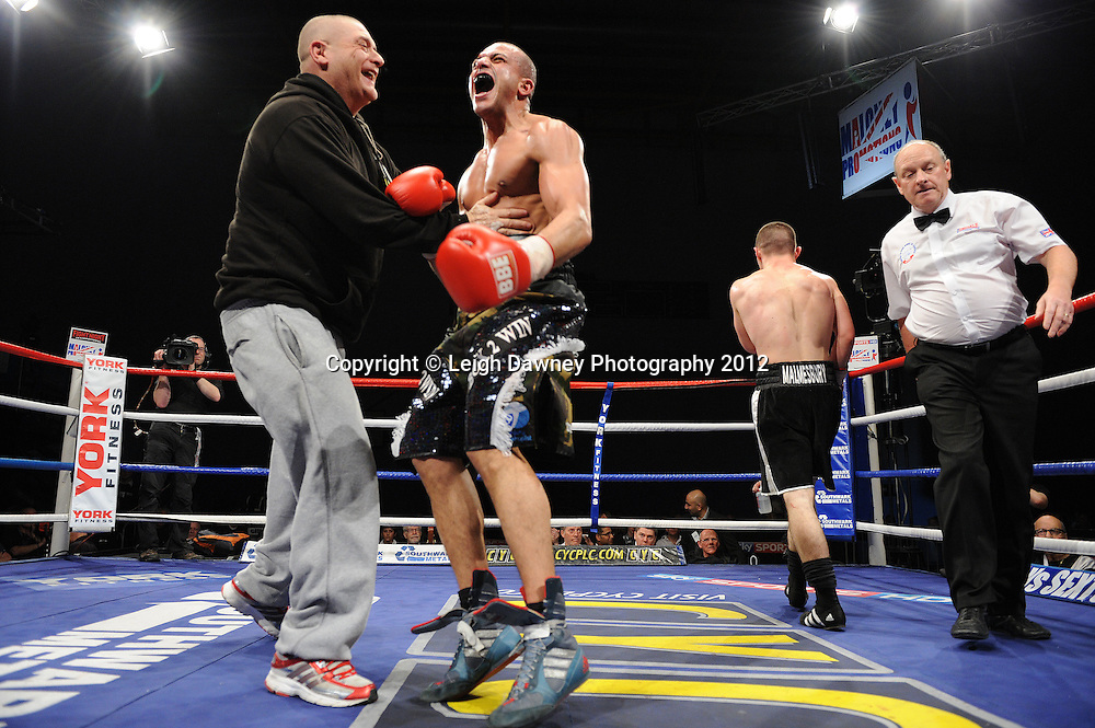 Joe Elfidh (pattern shorts) defeats Joe Hughes in a Light-Welterweight contest on 3rd March 2012 at the Hillsborough Leisure Centre. Frank Maloney & Dennis Hobson Promotions © Leigh Dawney Photography 2012.