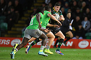 Northampton Saints fly half James Grayson (10) runs the ball under pressure from The Harlequins players during the Gallagher Premiership Rugby match between Northampton Saints and Harlequins at Franklins Gardens, Northampton, United Kingdom on 1 November 2019.