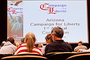 """Dec. 5, 2009 -- TEMPE, AZ: People wait for Rep. Ron Paul (R-TX) to arrive at the Arizona Campaign for Liberty Convention in the Memorial Union building on the Arizona State University campus in Tempe, AZ, Saturday. Rep. Paul is in the Phoenix, AZ, area over the weekend making speeches and signing his book, """"End the Fed."""" Saturday morning he spoke at the first annual """"Arizona Campaign for Liberty Convention."""" Most of the attendees supported Rep. Paul during his run for the Republican nomination for US President in 2008.   Photo by Jack Kurtz"""