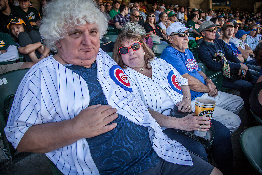 Chicago Cub fans John and Janice watch Cubs sweep the Oakland Athletics at the Colloseum in Oakland.
