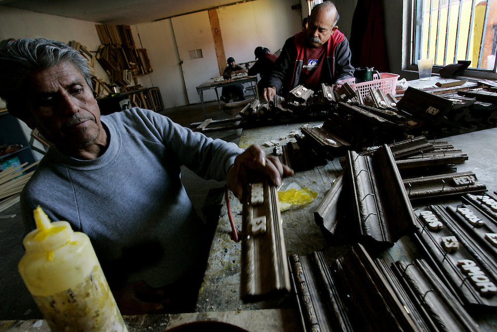 Rehab residents make wooden plaques at the Los Tesoros Escondidos Drug Rehabilitation Center  in Tijuana, Mexico.  The items are sold at local artisan shops and help raise money for the center