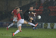 Salford City's Ibou Touray(3) in action with Sam Hoskins of Northampton during the EFL Sky Bet League 2 match between Salford City and Northampton Town at the Peninsula Stadium, Salford, United Kingdom on 11 January 2020.