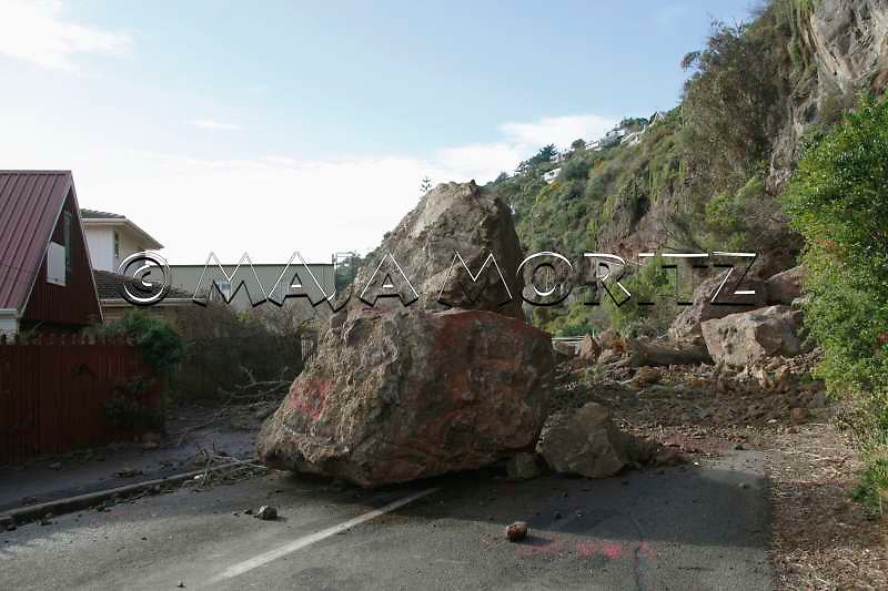 Huge boulders crashed down from the cliff on Heberden Avenue in the suburb of Sumner, Christchurch