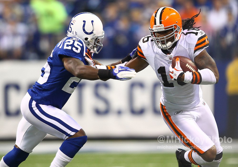 Sept. 18, 2011; Indianapolis, IN, USA; Cleveland Browns wide receiver Josh Cribbs (16) runs the ball as Indianapolis Colts cornerback Jerraud Powers (25) pursues at Lucas Oil Stadium.  Mandatory credit: Michael Hickey-US PRESSWIRE