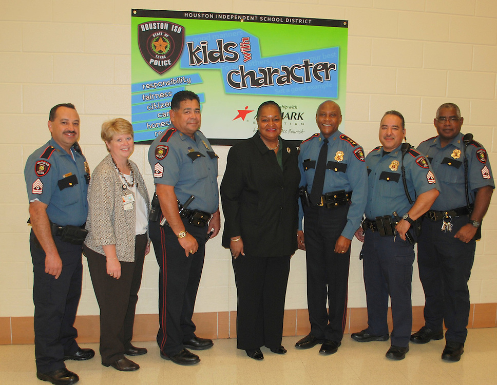 "Twice a month, HISD officers will eat lunch with students who have shown strong character to promote the ""Kids With Character"" mentoring program.  During the lunch the officers will also serve as role models by showing students how to be good leaders."