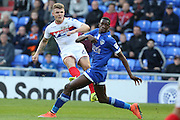 Max Power of Wigan Athletic tries a shot under pressure from Ousmane Fané of Oldham Athletic during the EFL Cup match between Oldham Athletic and Wigan Athletic at Boundary Park, Oldham, England on 9 August 2016. Photo by Simon Brady.