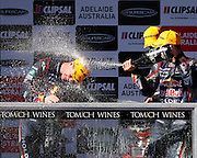 V8 Supercars. Clipsal 500. Adelaide Parklands Circuit.Adelaide. Australia. <br /> Saturday 2/3/2013. PODIUM <br /> Craig LOWNDES (Aus) Red Bull Racing Australia wins the 78 lap V8 Supercars race one.<br /> Here celebrating his teamate Jamie WINCUP (Aus) and Will DAVIDSON (Aus) Pepsi Max Crew FPR Ford.<br /> copyright: © ATP Damir IVKA<br />  - <br /> V8 Tourenwagen Rennen in Adelaide, Australien - 2013,  v8 Saloon car race named Clipsal 500 - Honorarpflichtiges Foto, Fee liable image, Copyright © ATP Damir IVKA