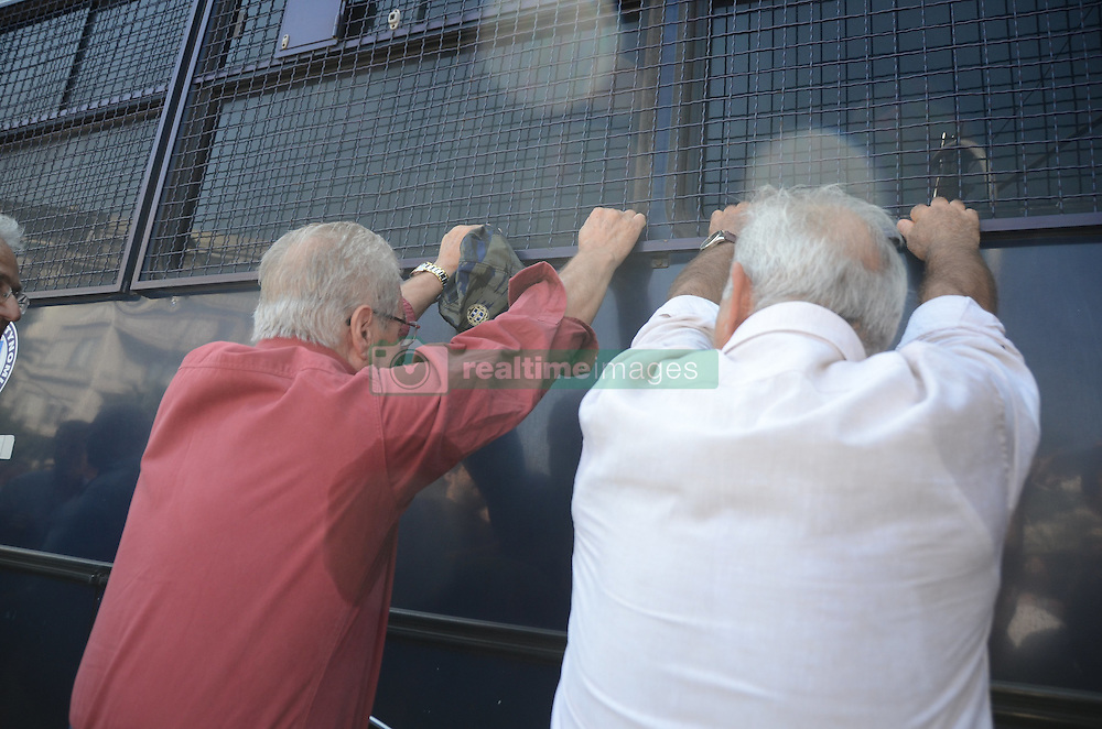 October 3, 2016 - Athens, Greece - Pensioners try to move along a riot police van in order to pass through.Greek pensioners demonstrate in Athens against the goverment cuts on pensions and their benefits in General. Demonstrators clashed with riot policve after they found the road to Prime Ministers office closed by police. (Credit Image: © George Panagakis/Pacific Press via ZUMA Wire)
