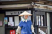 Japanese gardener works in a garden