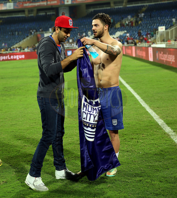 Ranbir Kapoor, actor and co-owner of Mumbai City FC and Tiago Ribeiro of Mumbai City FC after the match 52 of the Hero Indian Super League between Mumbai City FC and Atletico de Kolkata held at the D.Y. Patil Stadium, Navi Mumbai, India on the 7th December 2014.<br /> <br /> Photo by:  Sandeep Shetty/ ISL/ SPORTZPICS