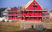 ATBK3C Building site with red cladding and scaffolding as new houses are built Rendlesham Suffolk