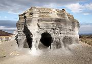 Layers of black volcanic ash quarried by humans and eroded by nature, Lanzarote, Canary islands, Spain