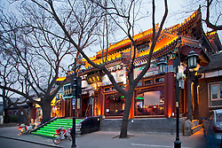 Resplendant in its early evening lights and neon, a restaurant awaits customers in the Shichahai (Houhai) District at Twilight, Beijing, China.