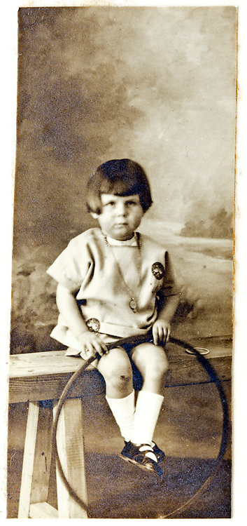 1900s studio portrait of small child with a hula hoop